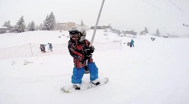 a baby snowboarder in avoriaz kidscanride com